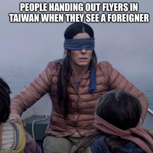 People handing out flyers in Taiwan when they see a foreigner