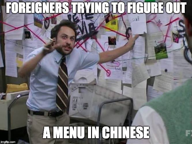Foreigners trying to figure out a menu in Chinese